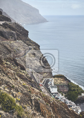 Vintage toned picture of Tenerife mountainous coast on a cloudy day, Spain.