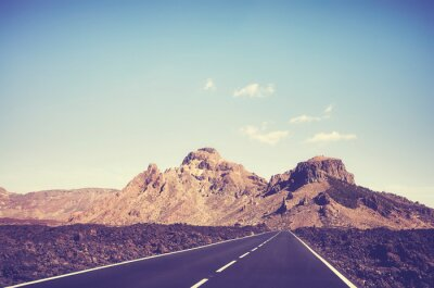 Vintage toned scenic road with volcanic scenery in Teide National Park, Tenerife, Spain.