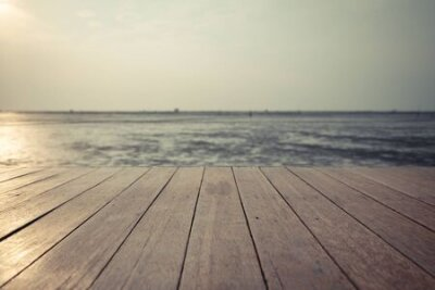 Obraz Vintage  wood floor extends into the sea when the water drops