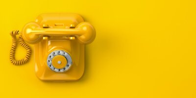 Obraz vintage yellow telephone on yellow background. 3d illustration