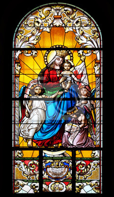 Obraz Virgin Mary with baby Jesus and Angels, stained glass window in the Saint John the Baptist church in Zagreb, Croatia