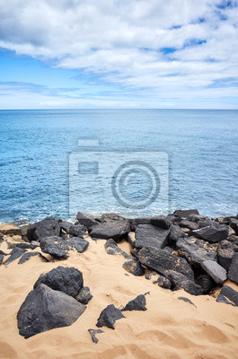Volcanic rocks on Playa de Las Teresitas beach, Tenerife, Spain.