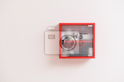 Obraz Wall mounted first aid kit on light background