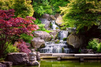 Obraz Waterfall long exposure with maple trees and bridge in Kyoto Japanese green Garden in Holland Park green summer zen lake pond water in London, UK