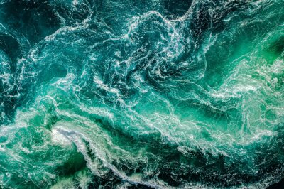 Obraz Waves of water of the river and the sea meet each other during high tide and low tide.