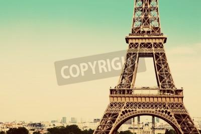 Obraz Wieża Eiffla w środkowej części, miasto w tle, Paryż, Francja. Vintage, retro styl