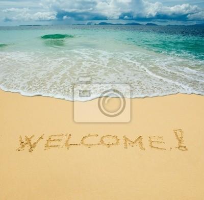 Witamy napisany w piaszczystej plaży tropikalna