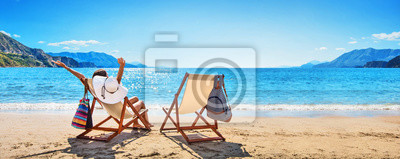 Obraz Woman Enjoying Sunbathing at Beach