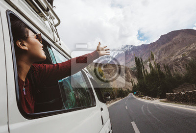 Obraz Woman enjoying the cool breeze from the car window