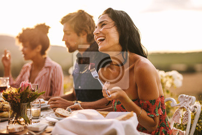 Obraz Woman enjoying with friends at outdoor dinner party