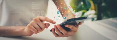 Obraz Woman hand using smartphone and show icon social media. Network technology concept.