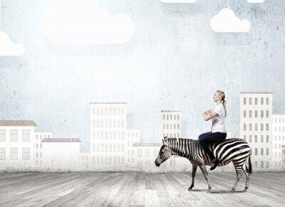 Obraz Woman ride zebra