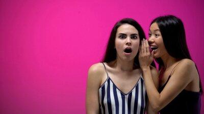 Obraz Woman telling unbelievable news to her shocked friend, girls secrets, gossip