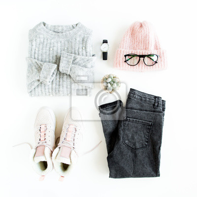 Obraz Women fashion clothes and accessories. Feminine youth collage on white background top view. Flat lay female style look with warm sweater, jeans, hat, sneakers, glasses. Top view.