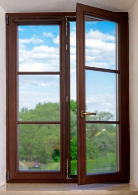 Obraz wood plastic vinyl window on a background blue sky