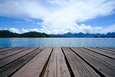 Obraz Wooden platform floor with beautiful lake. tropical nature background.