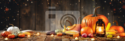 Obraz Wooden Table With Lantern And Candles Decorated With Pumpkins, Corncobs, Apples And Gourds With Wooden Background - Thanksgiving / Harvest Concept