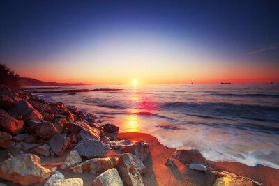 Obraz Wschód słońca nad morzem