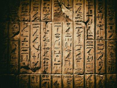 Obraz Wyblakły starożytny egipski hieroglif wyrzeźbiony w piaskowcu