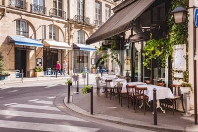 Obraz Wygodna ulica z stołami kawiarnia w Paryż, Francja