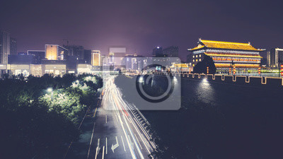 Xian skyline with City Wall at night, color toned picture, China.