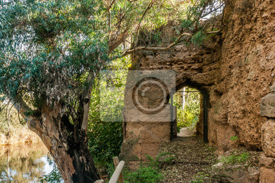 """Door in the rampart of medieval stone that surrounds the village of """"Niebla """", in the province of Huelva, Spain. His access gives to the Tinto River. The rampart is the largest of its kind in Europe."""