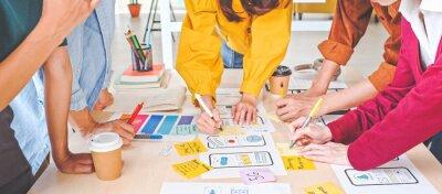 Obraz Young Asian business creative team work together, mobile application software design project. Brainstorm meeting, internet technology, smartphone web app designer, office coworker teamwork concept