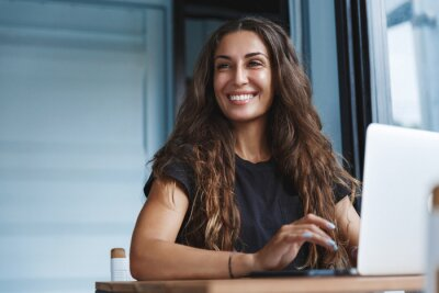 Obraz Young businesswoman manage business from home on remote, freelancer using laptop sit kitchen table on self-quarantine, work over personal growth, apply for online courses to learn new skills