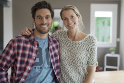 Obraz Young couple face camera inside the house