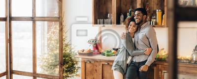 Obraz Young loving couple having good time at christmas morning