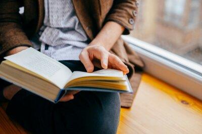 Obraz Young man reading a book