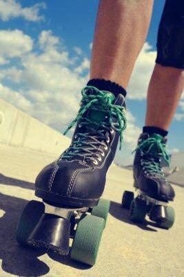 Obraz young man roller skating