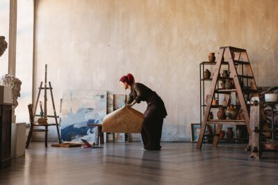 Obraz Young white woman painter in an art studio