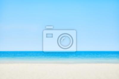 Zamazany obrazek plaża na słonecznym dniu, natury tło