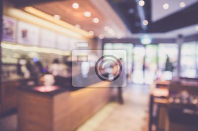 Obraz Zamazany tło robić z roczników brzmieniami, sklep z kawą zamazuje tło z bokeh i pracującym mężczyzna w kawiarni