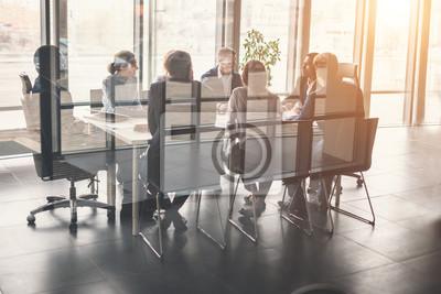 Obraz Zespół firmy i menedżer w spotkaniu