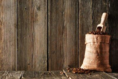 Obraz Ziarna kawy i miarka w worku