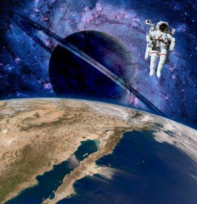 Obraz Ziemia planeta zewnętrzna astronauta kosmita kosmonauta saturn. Elementy tego zdjęcia dostarczone przez NASA.