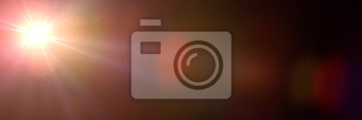 Obraz złoty efekt flary obiektywu nakładki tekstury w odcieniach pomarańczy i czerwieni z bokeh przed czarnym tle transparentu