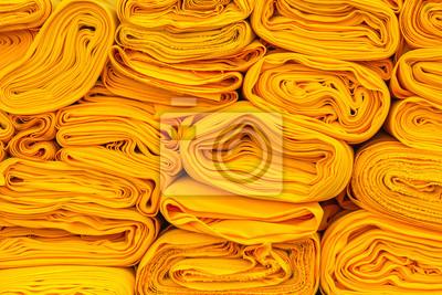 Obraz zwoje tkaniny żółte szaty