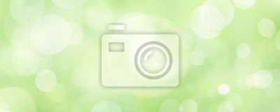 Plakat A fresh spring green garden foliage background with blurred bokeh.