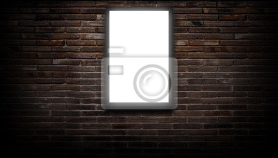 Plakat A white light box or billboard hanging on a black brick wall background in a night building