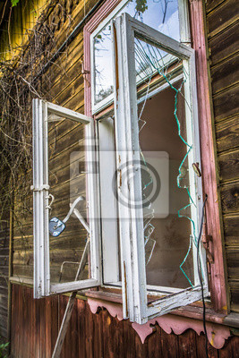 Plakat Abandoned wooden building with a broken window