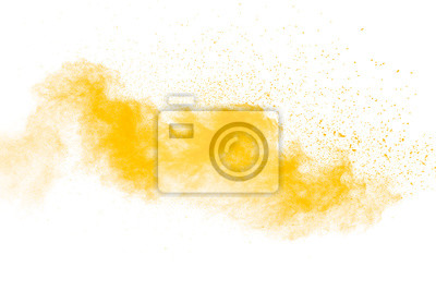 Plakat Abstract yellow powder explosion on white background.Freeze motion of yellow dust particles splash.