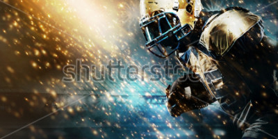 Plakat American football sportsman player on stadium running in action. Sport wallpaper with copyspace.