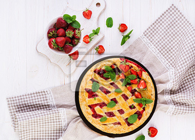 American strawberry pie tart cake sweet baked pastry food on white wooden table. Top view