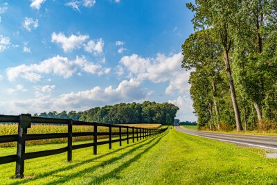 Plakat Amish country field agriculture, beautiful brown wooden fence, farm, barn in Lancaster, PA US