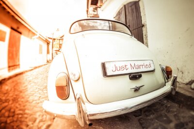 Plakat Antique wedding car with just married sign