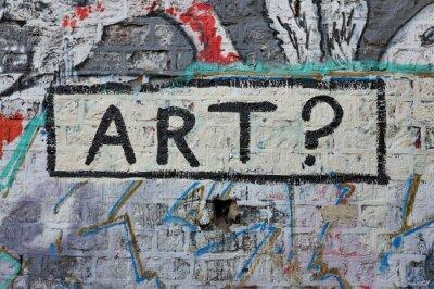 Plakat Art? Graffiti sur mur de briques dans la rue.