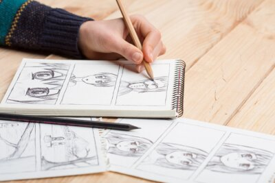 Plakat Artist drawing an anime comic book in a studio.